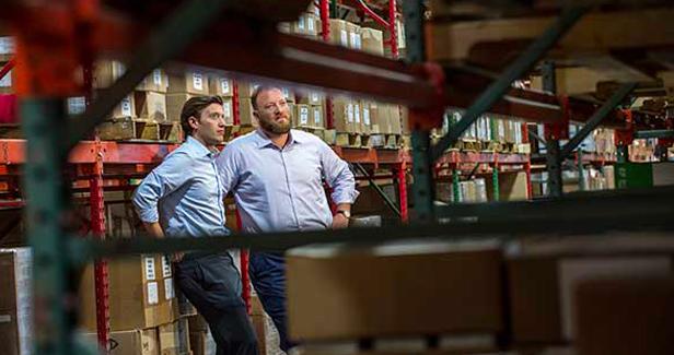 Ben Grossman and David Grossman in warehouse.